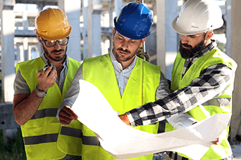 construction workers reading a plan